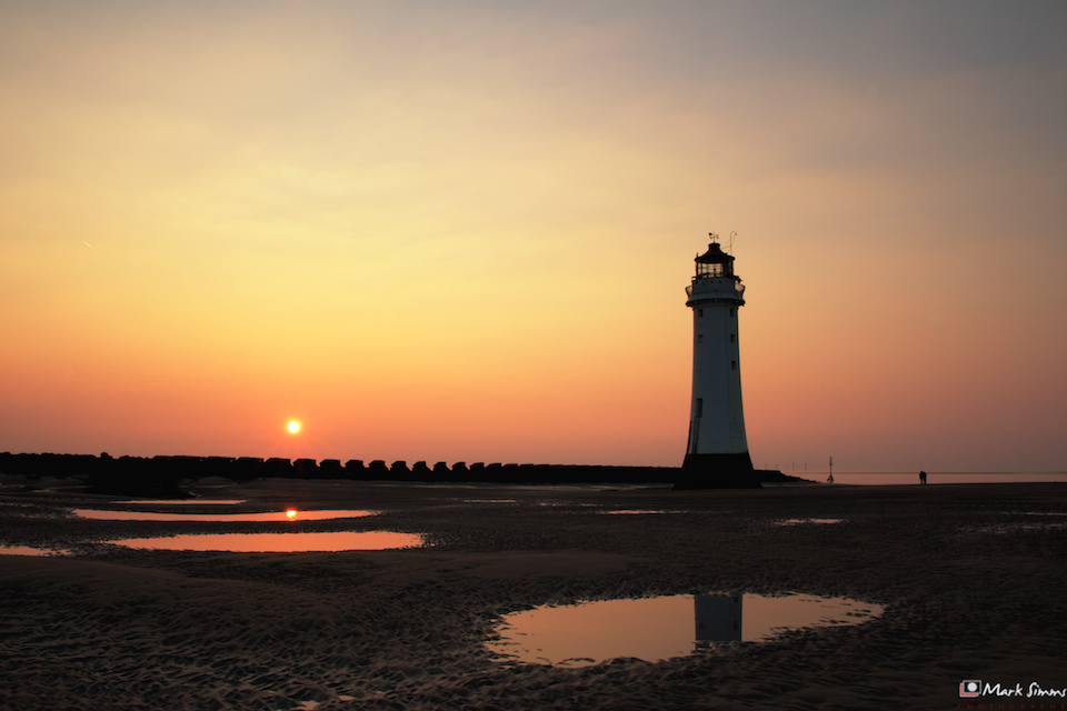 A beautiful sunset at New Brighton with the Perch Rock Lighthouse semi-silhouetted on the horizon