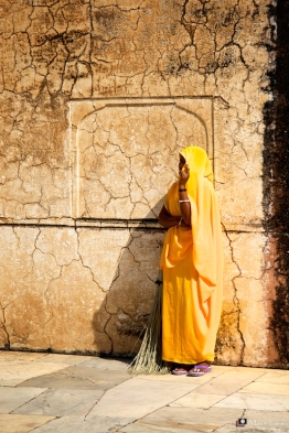 Lady, Sun-baked Wall, Amber Fort, Jaipur, Rajasthan, India